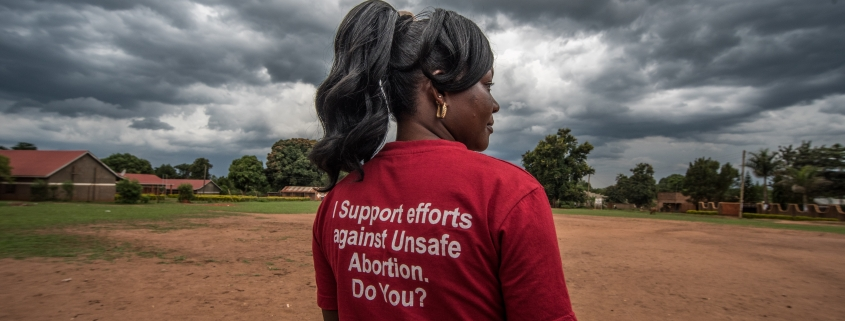 Milly Namulindwa, a teacher and VODA community volunteer, wears a t-shirt advocating for safe abortions in Kasawo, Uganda.